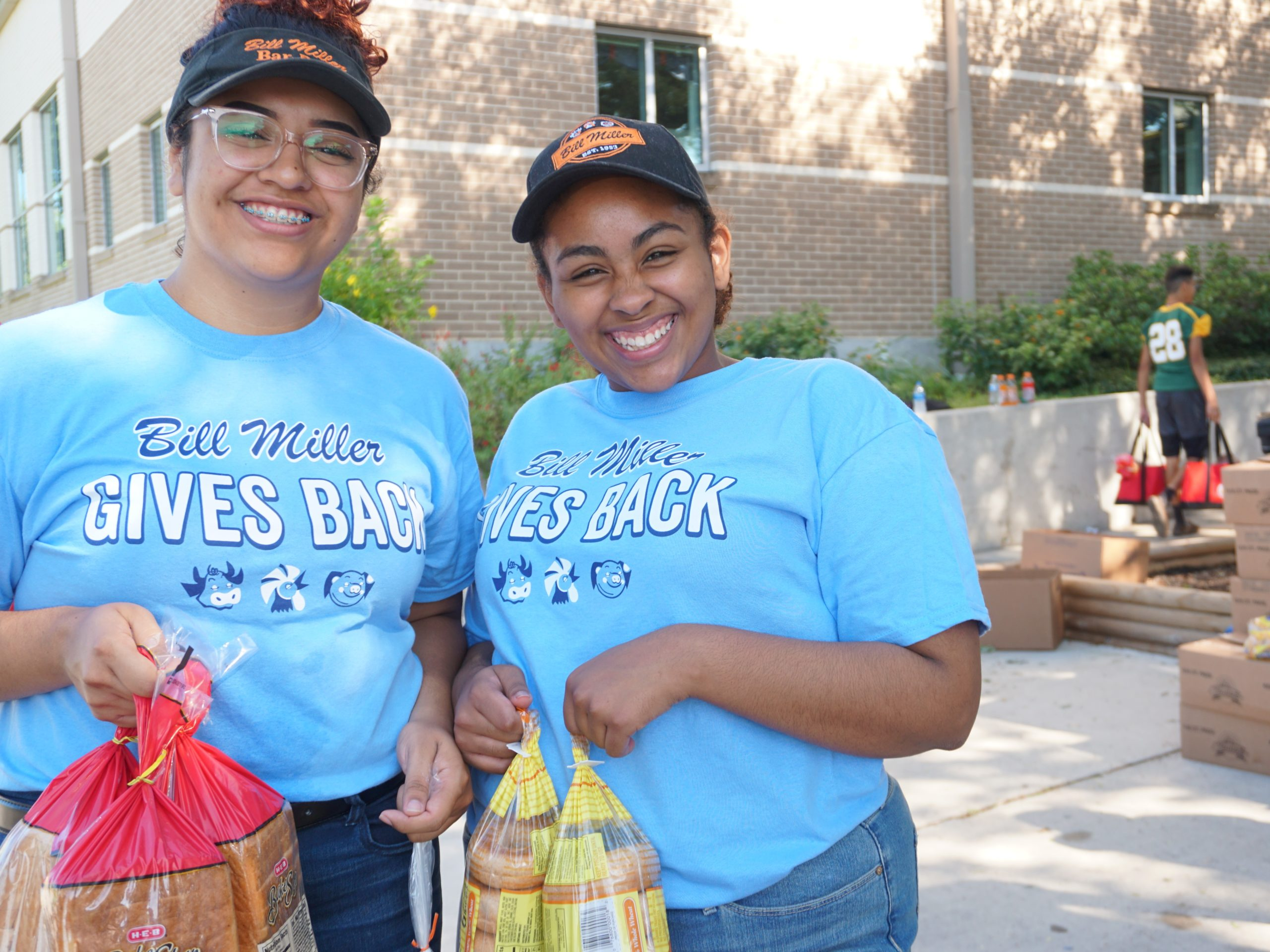Two Bill Miller employees volunteering with San Antonio Food Bank